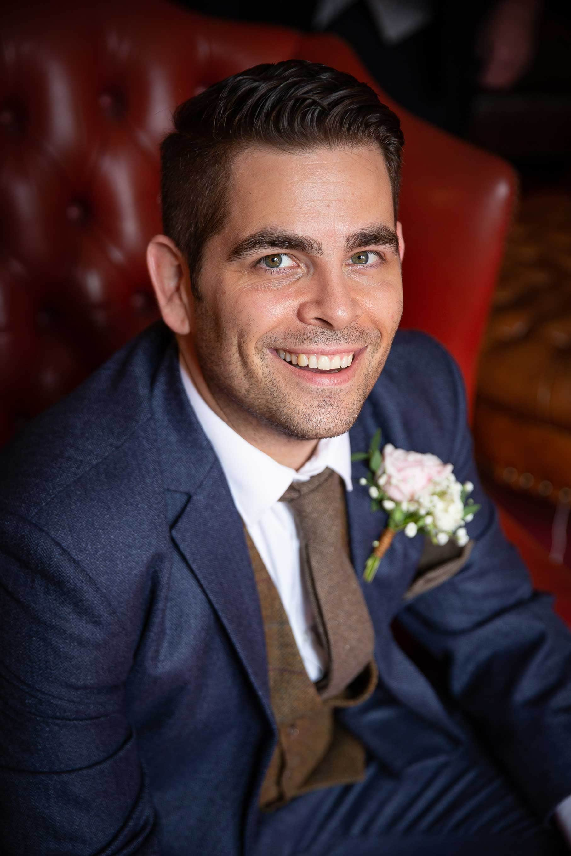 close up photo of the groom at Ellingham Hall