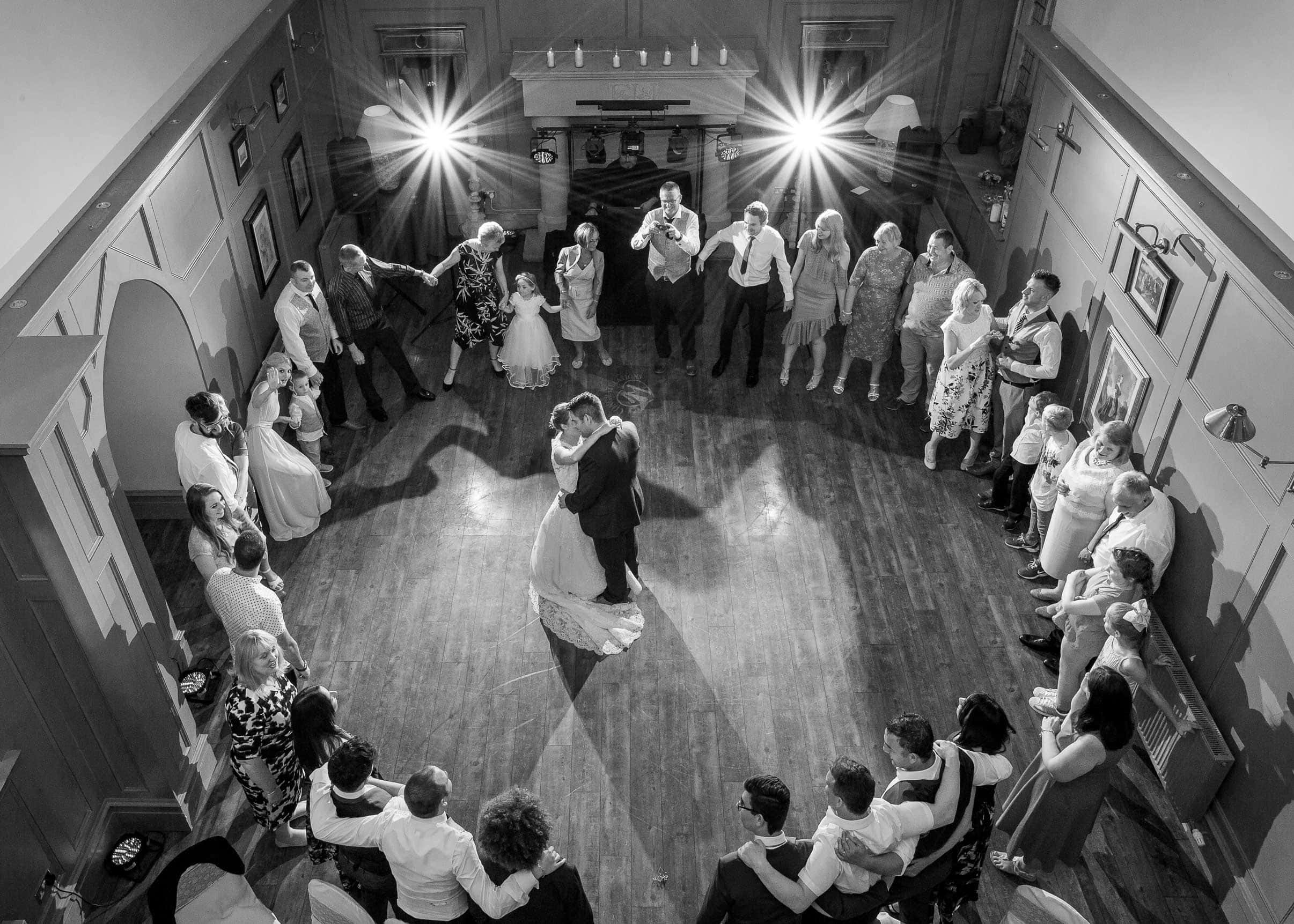 Photo of the bride and groom having their first dance