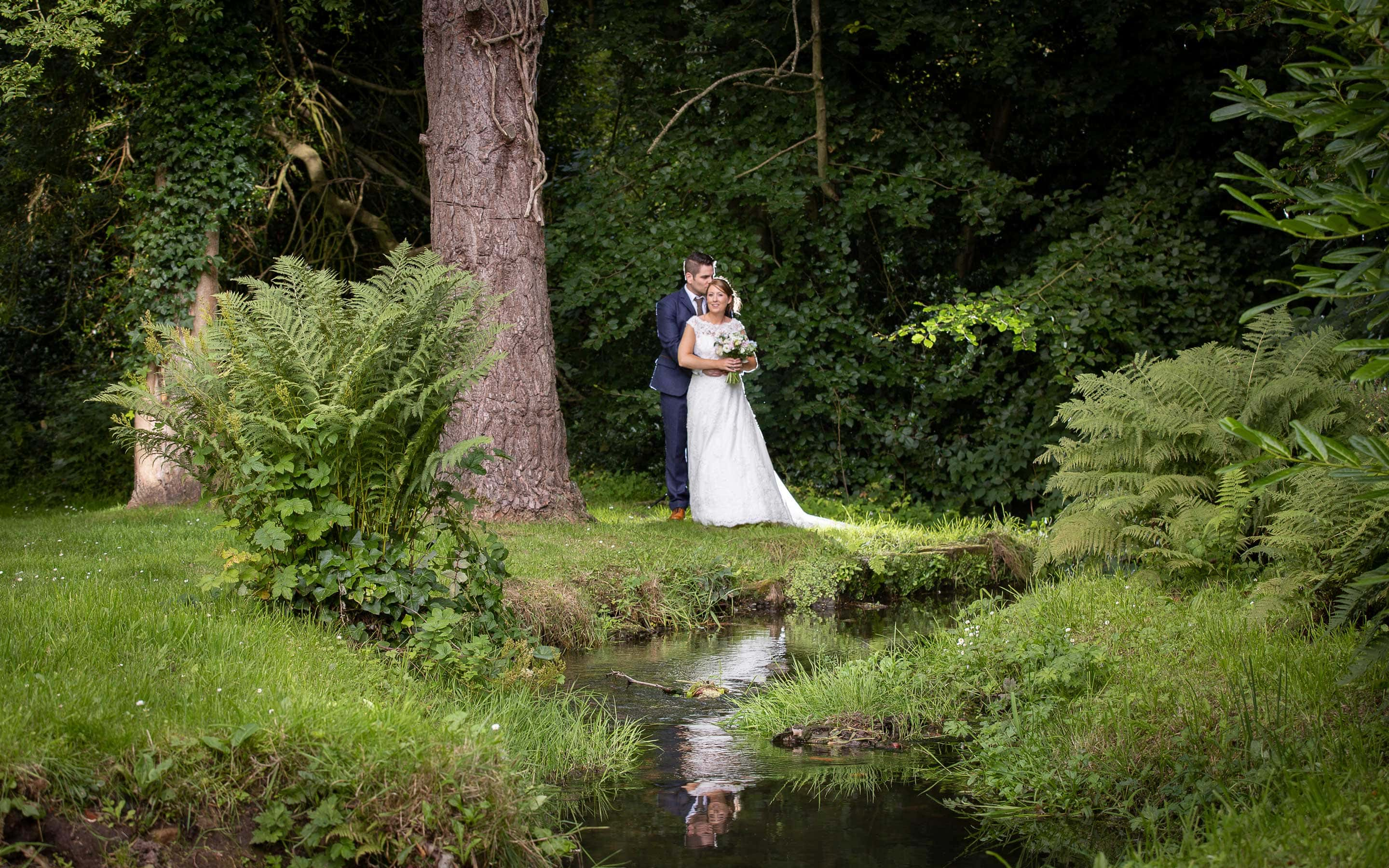 Photo at Ellingham Hall of the bride and groom