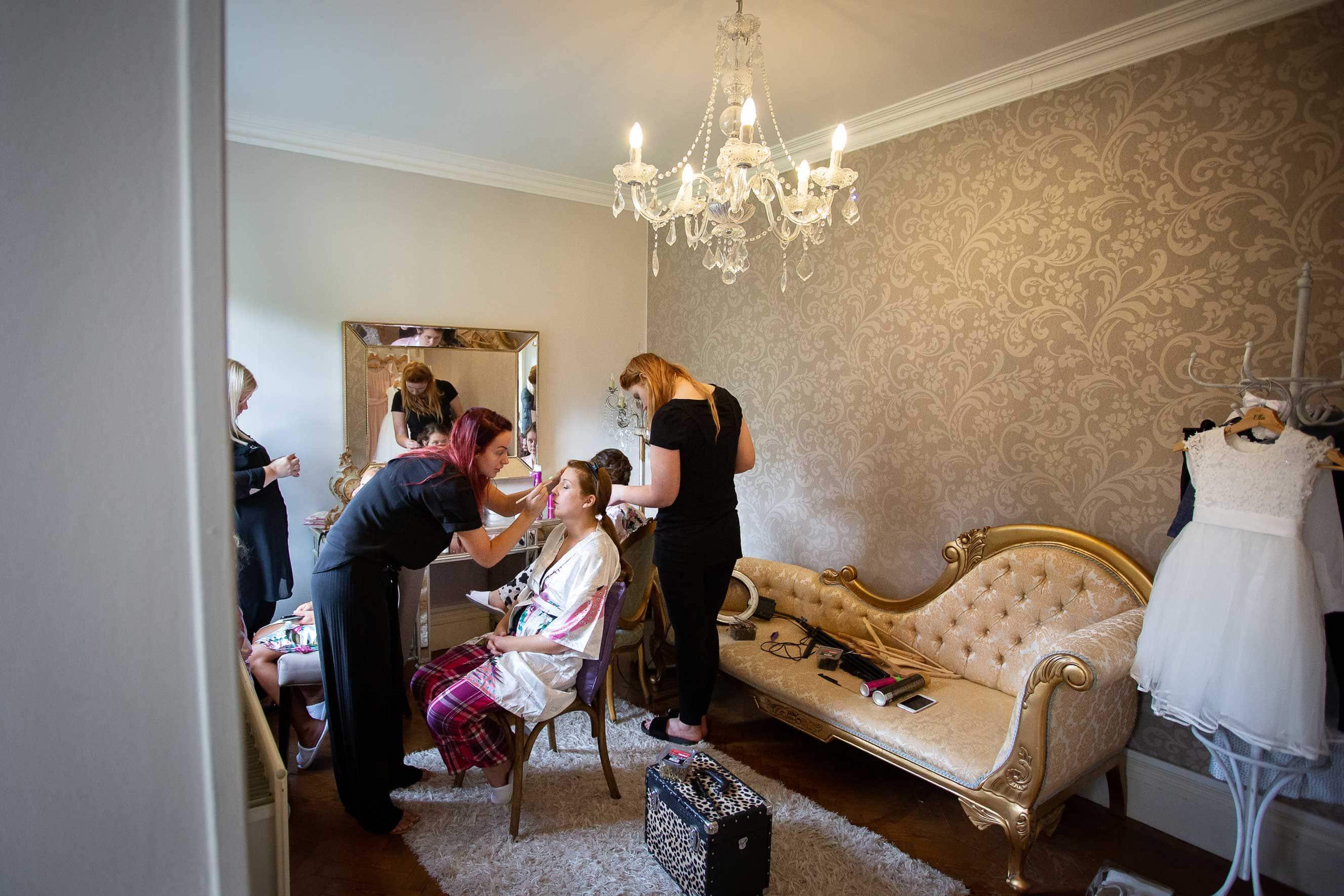 bride getting ready at Ellingham hall