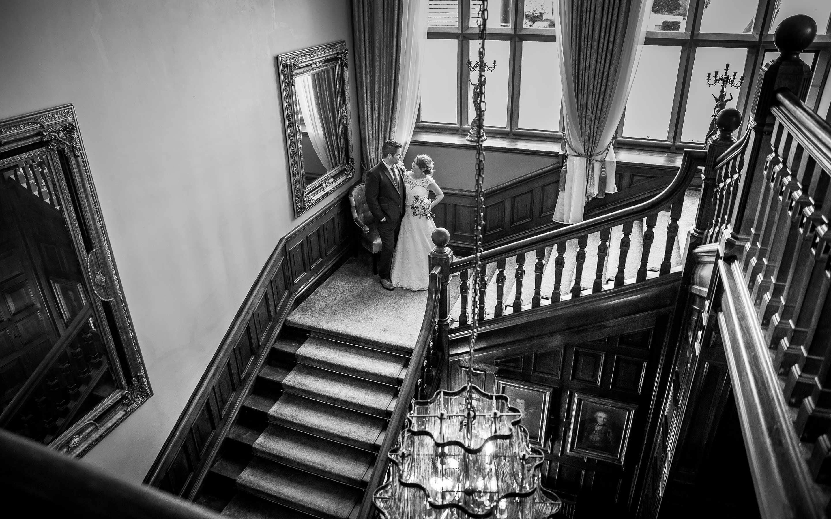 Bride and groom standing on the staircase