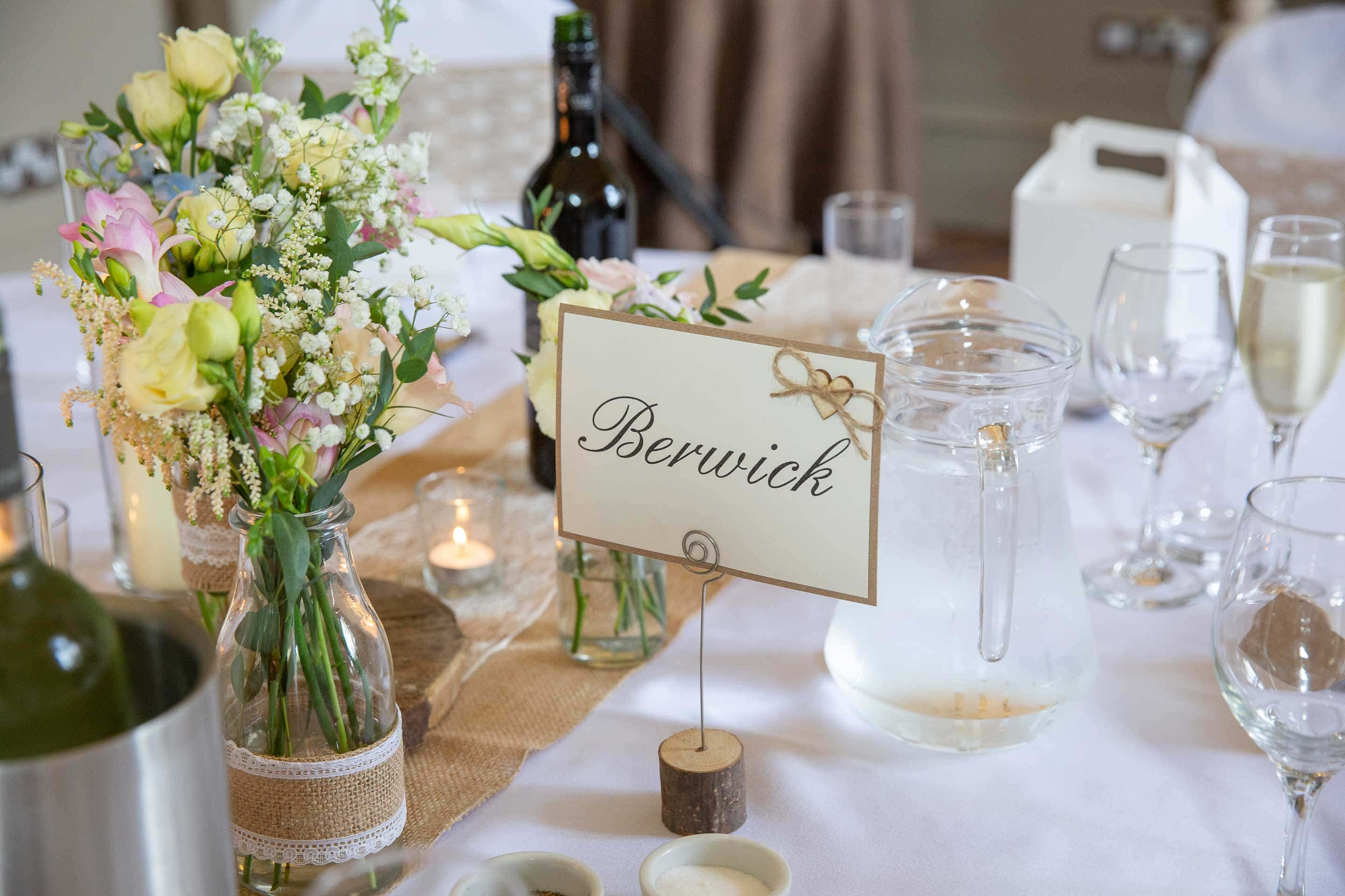 Photo of a table at the wedding breakfast at Ellingham Hall