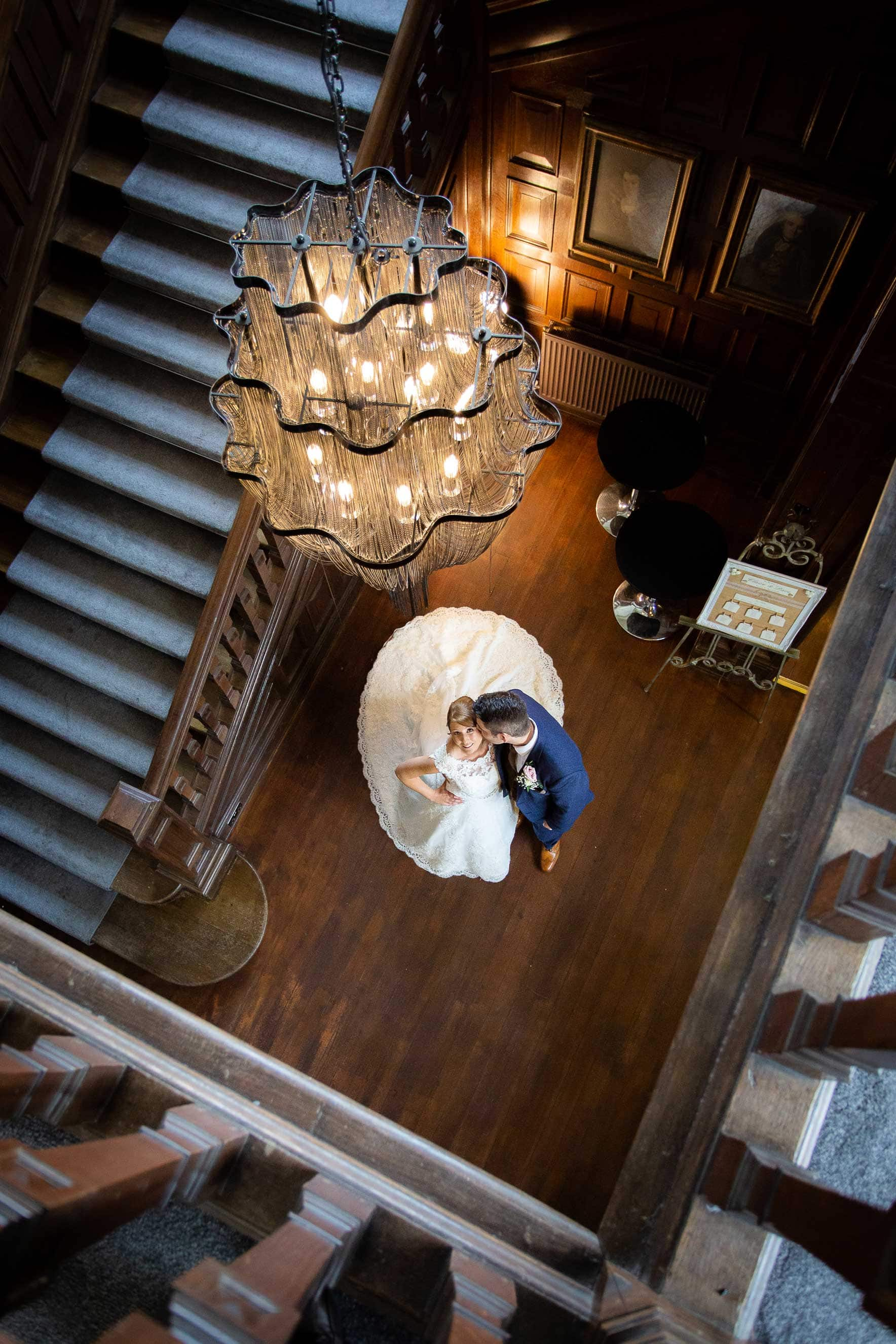Wedding photo of bride and groom on the stair case