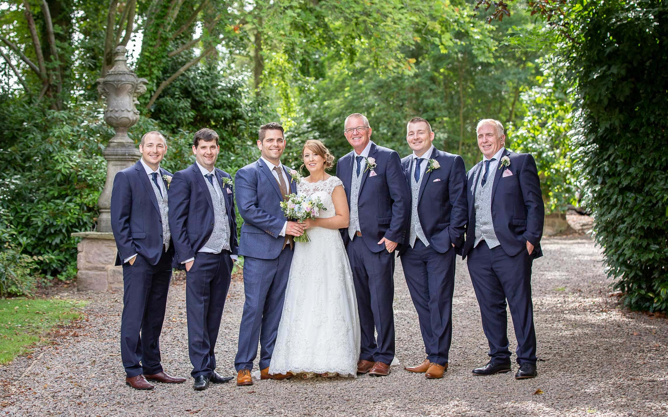 Wedding photo of the bride and groom with the grooms men