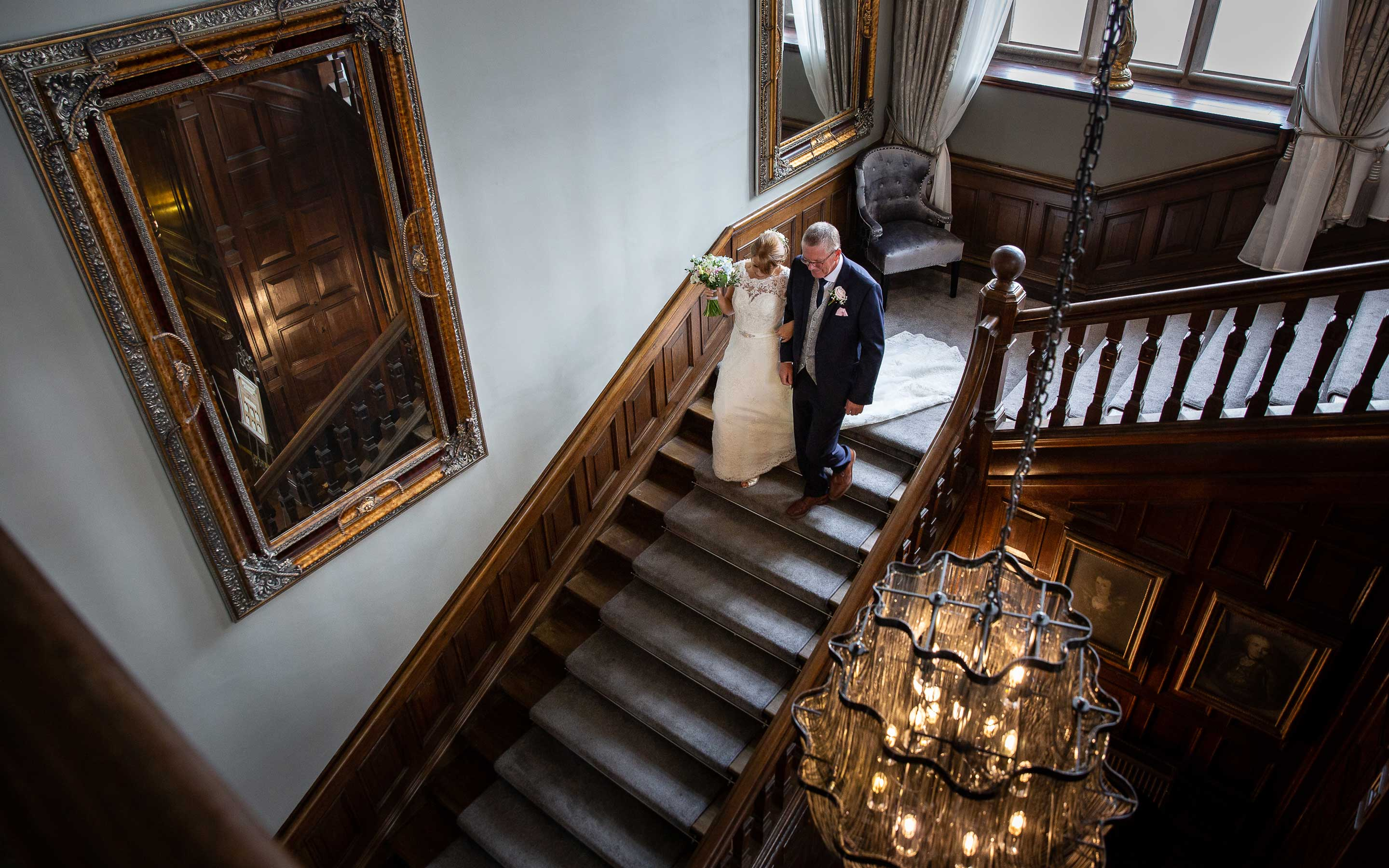 Bride walking down the stairs with her father