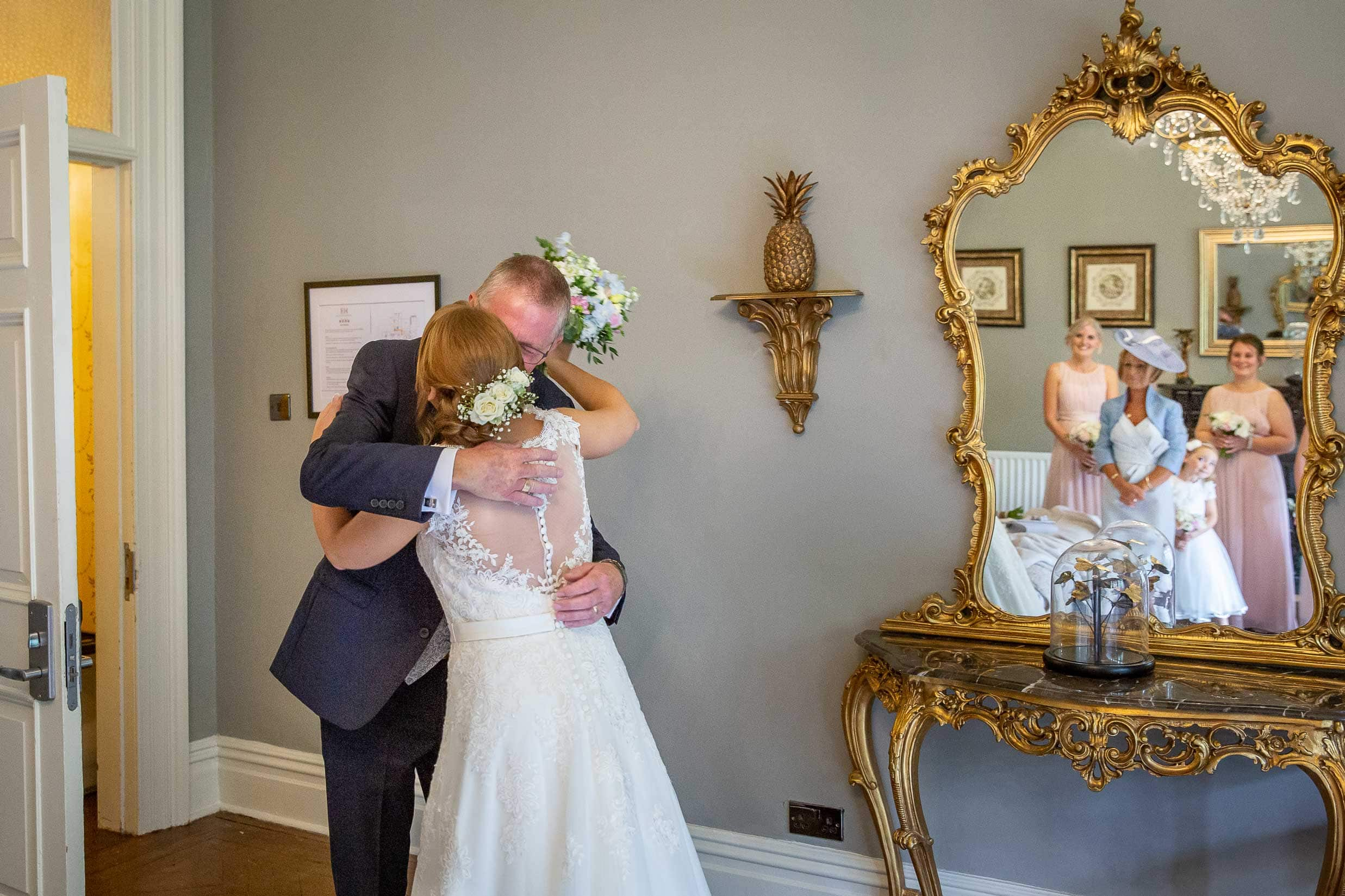 father hugging bride at Ellingham hall
