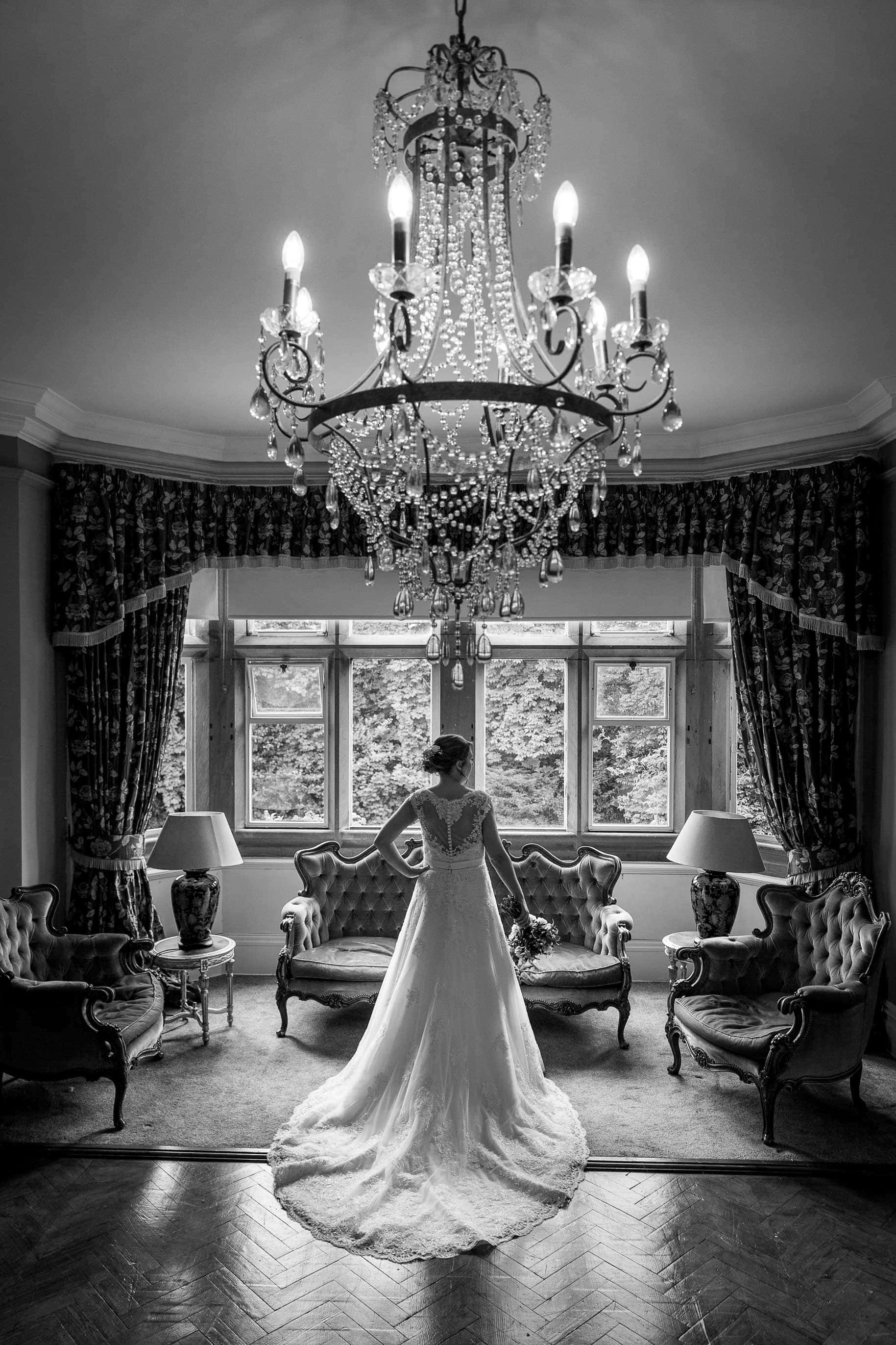 Black and white photo of a bride at Ellingham Hall