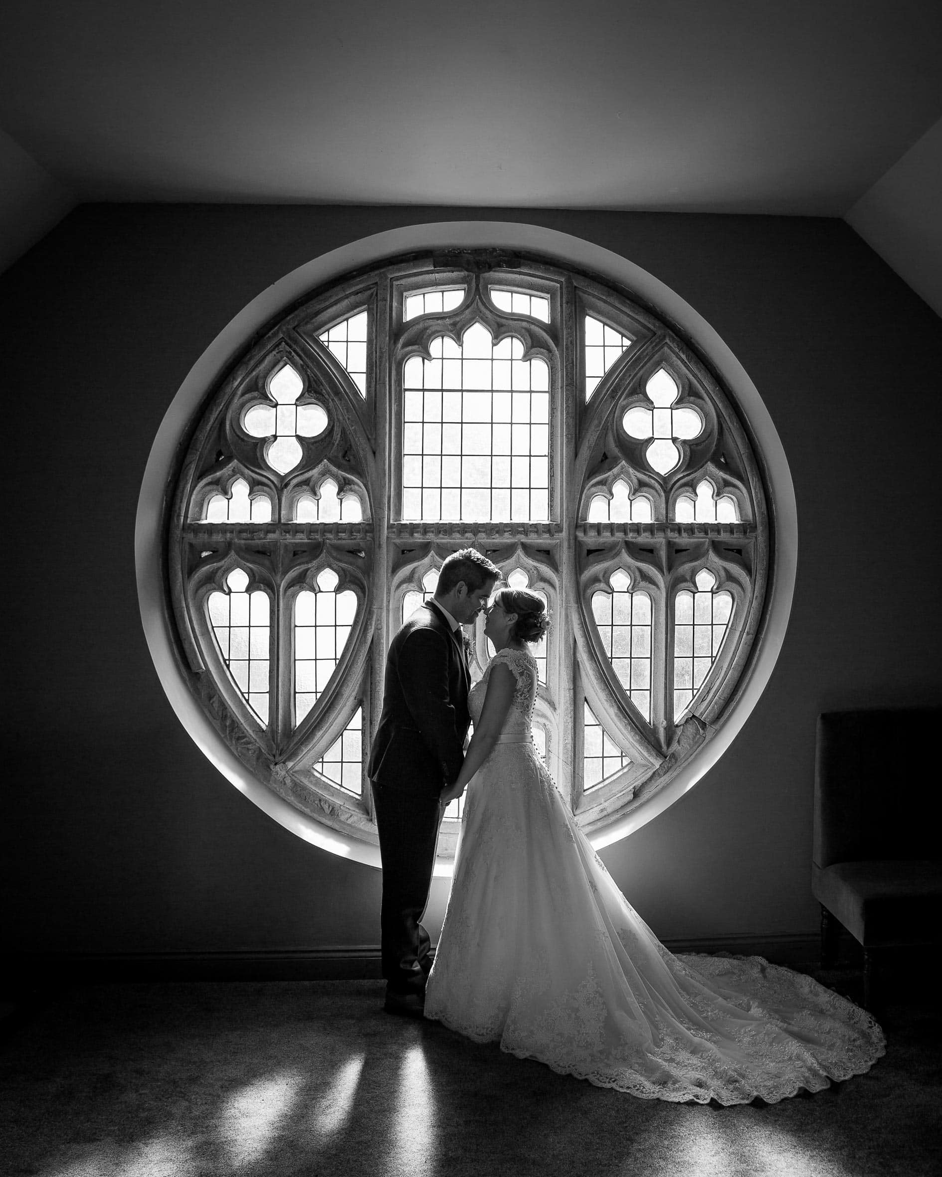 Black and white wedding photo of bride and groom