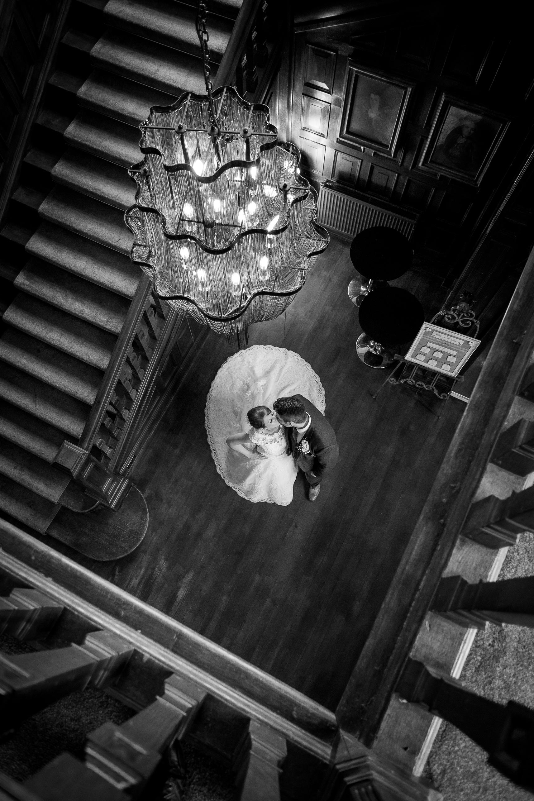 Wedding image of bride and groom standing near a staircase
