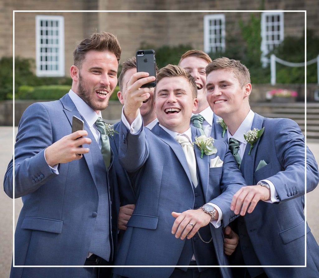 groom and the groomsmen taking a selfie