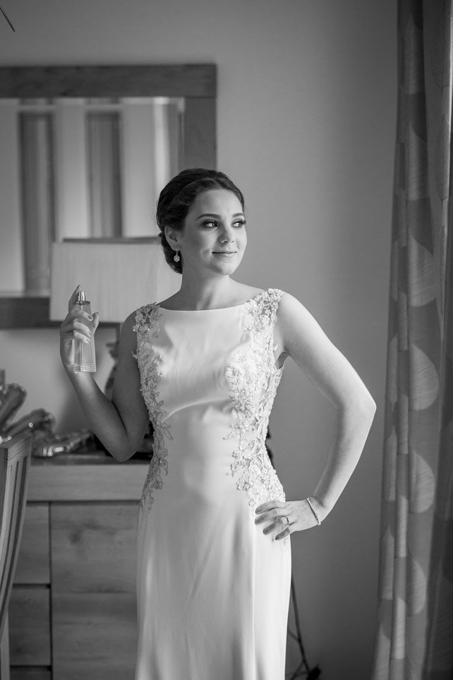 Photo of bride putting on Perfume