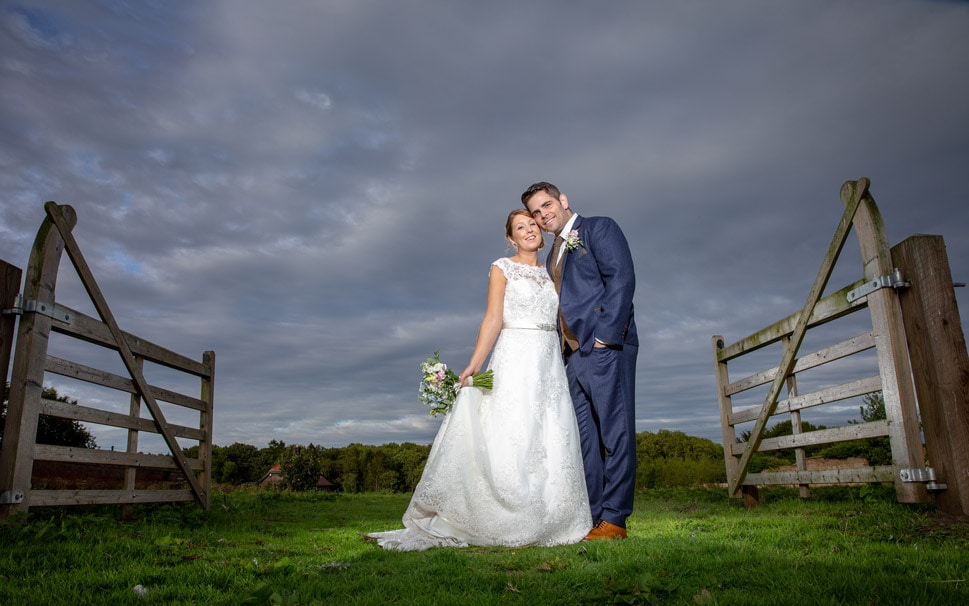 Photo of Bride and groom at Ellingham Hall looking in to camera