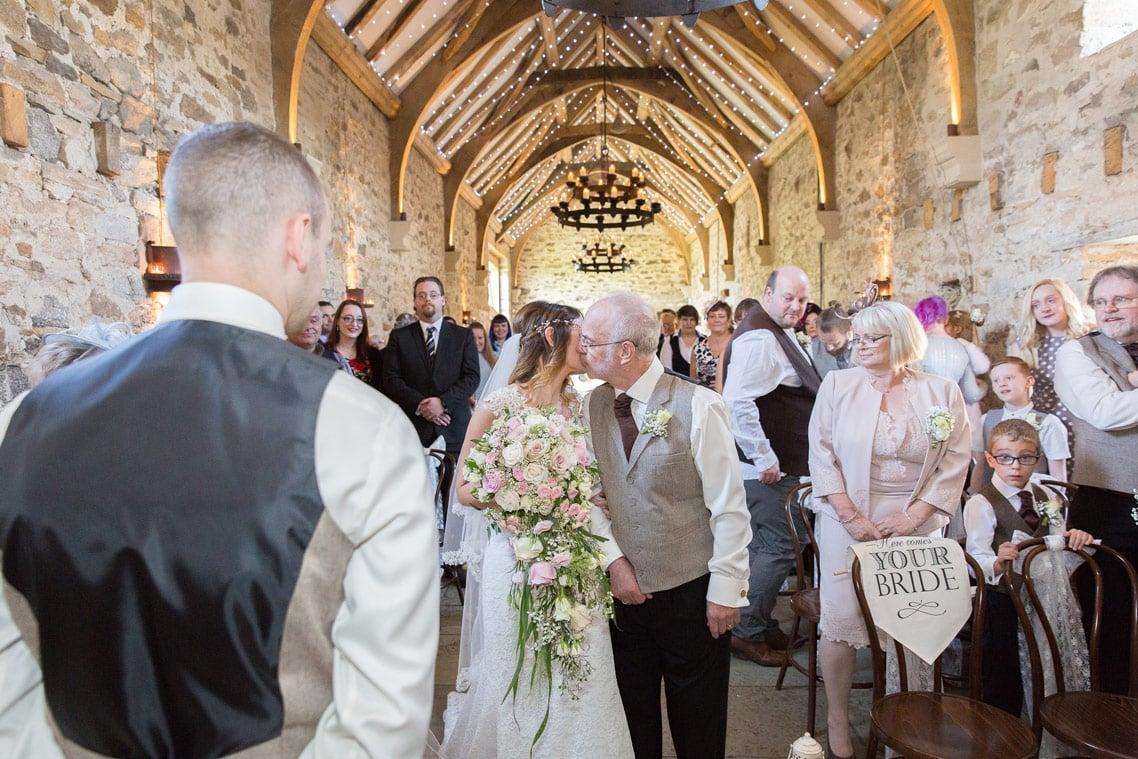 Bride walking down aisle at healey Barn