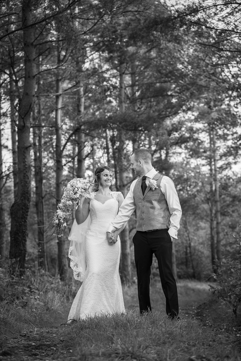 Photo of Bride and Groom in woods near Healey Barn