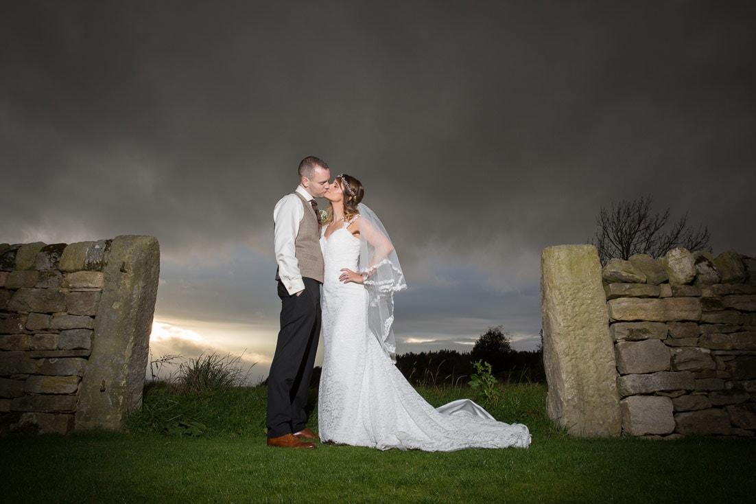 Bride and groom kissing at Healey Barn