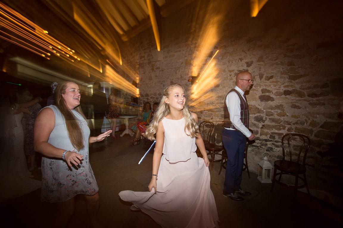 Girl dancing at Wedding reception at Healey Barn