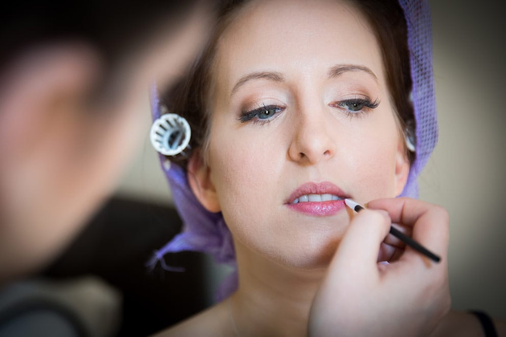 Photo of bride having makeup done
