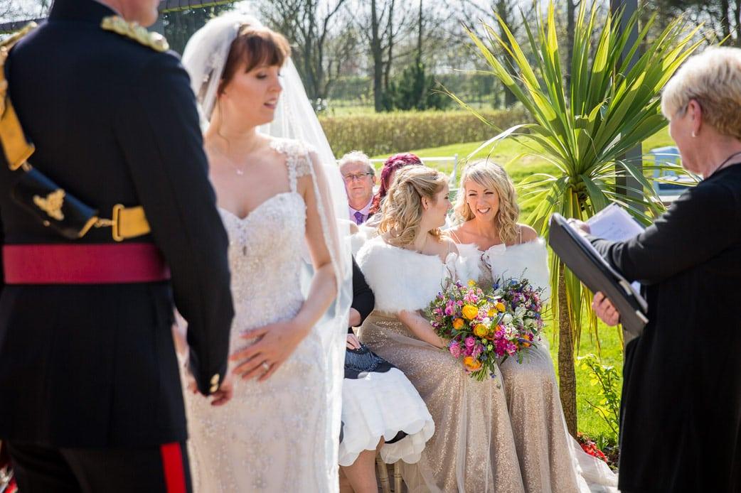 Photo of Bridesmaids during wedding ceremony