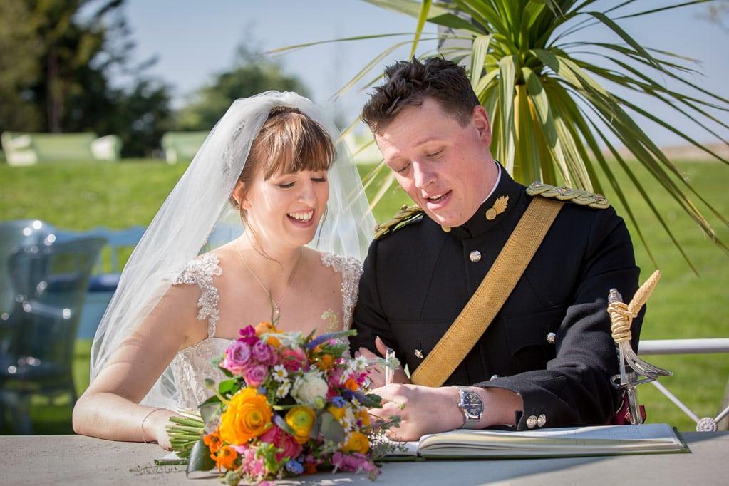 Couple signing the registrar