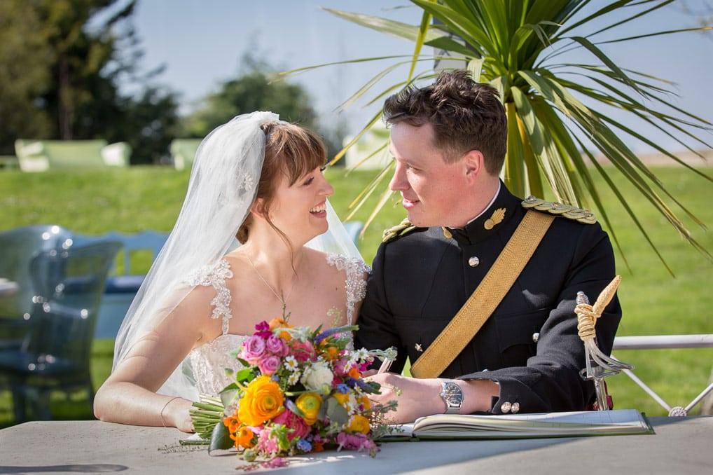 Bride and Groom signing registrar