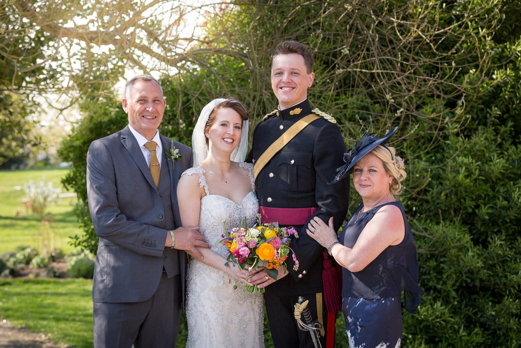 Bride and Groom standing with parents