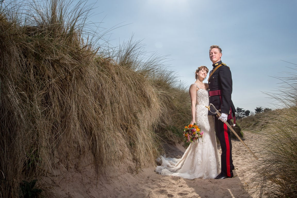 Photo of bride and groom on beach