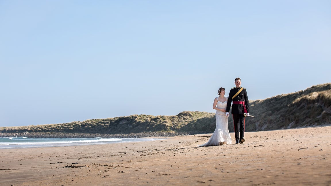 Photo of Bride and Groommon beach