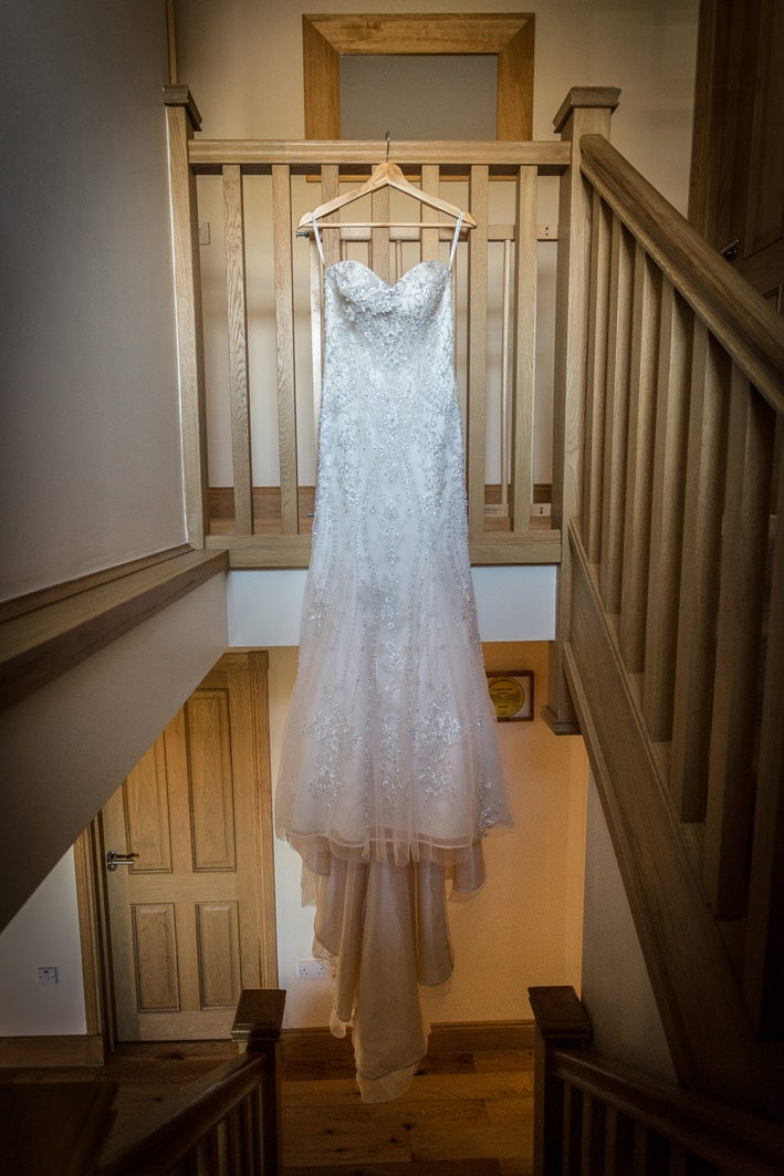 Photo of brides dress hanging up