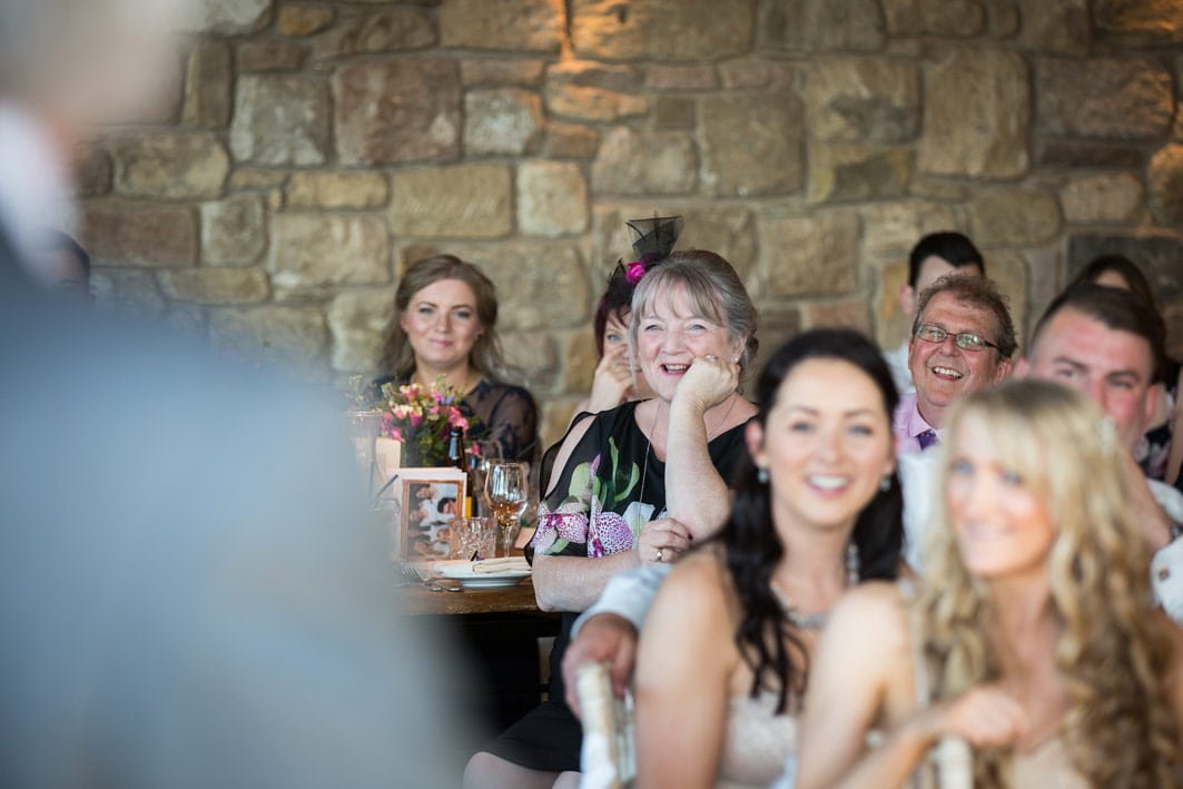 Laughter during speeches at Newton Hall