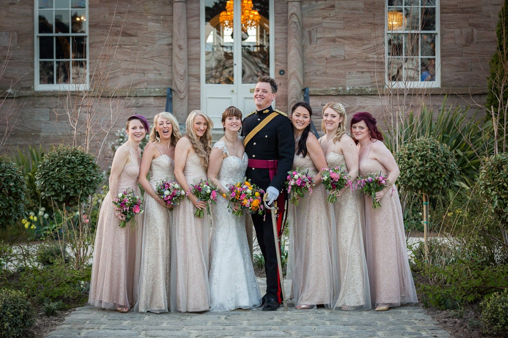 Photo of wedding couple with bridesmaids