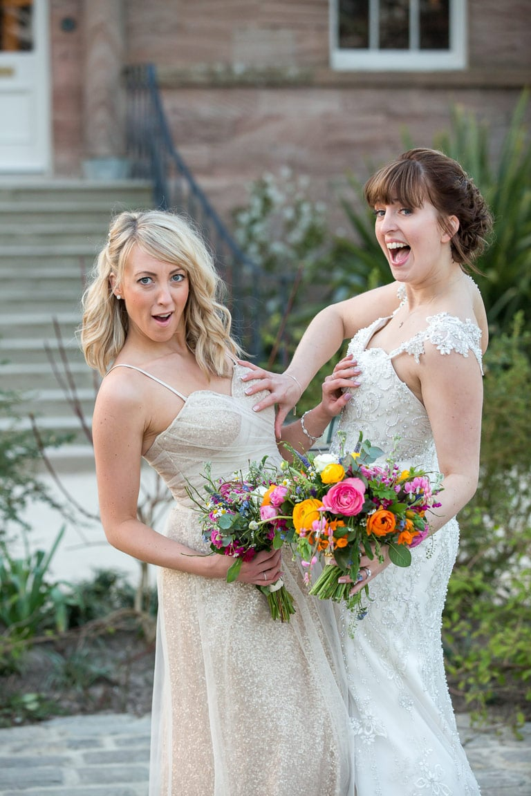 Photo of bride and bridesmaid being silly