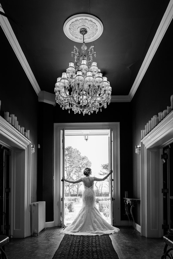 Black and white photo of bride at Newton Hall