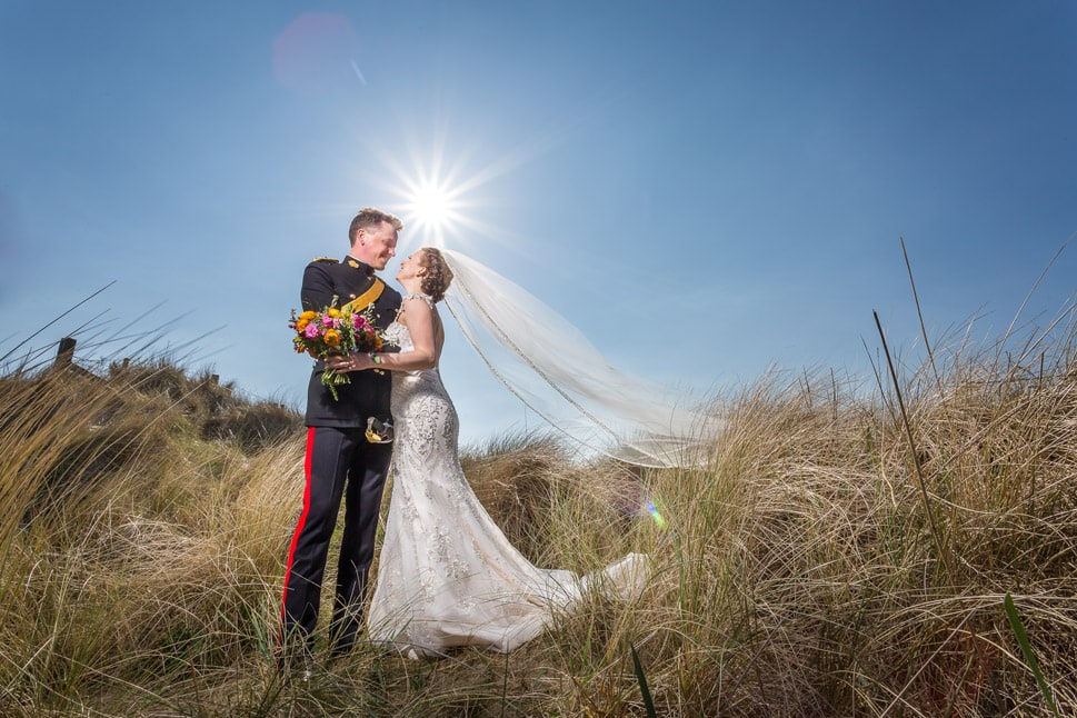 Photo of bride and groom on beach near Newton Hall