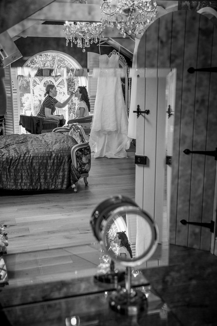Black and white photo of Bride getting ready at Woodhill Hall