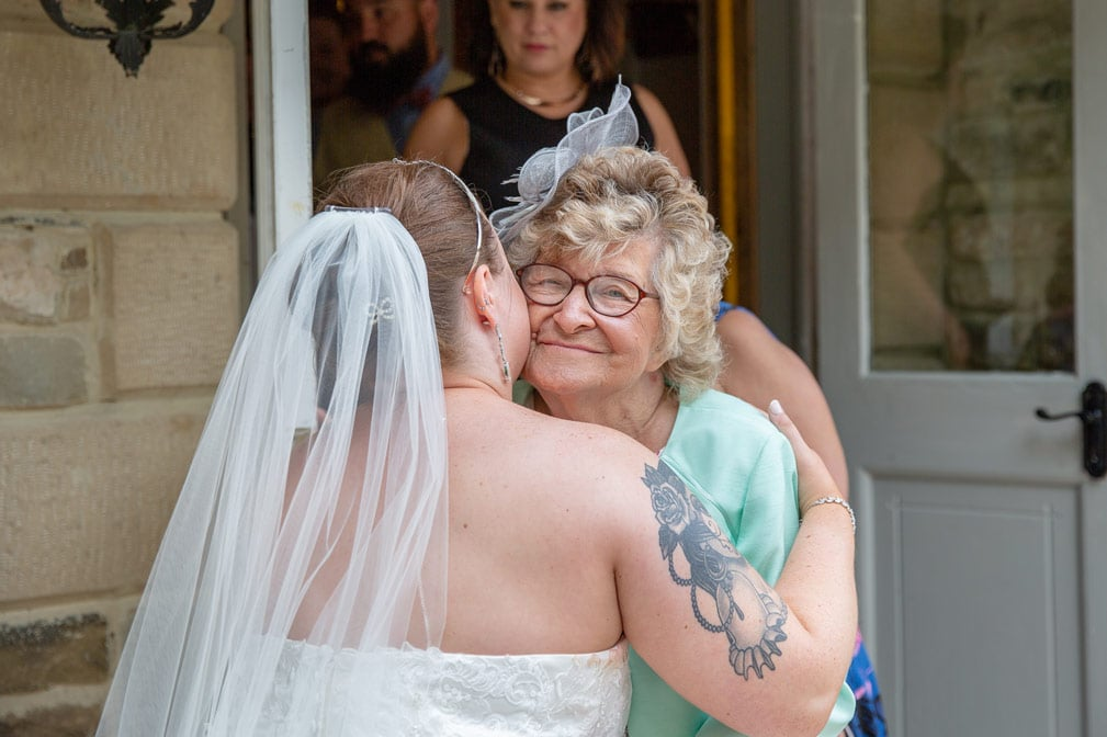 Family Greeting brides at Woodhill Hall