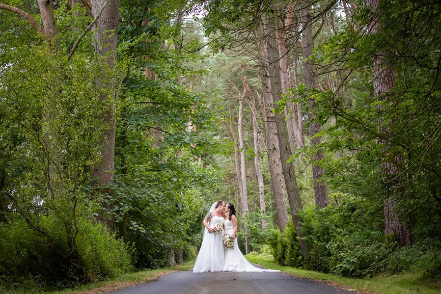 Brides Kissing at Woodhill Hall