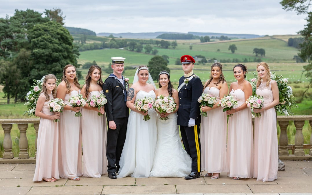photo of wedding party at Woodhill Hall