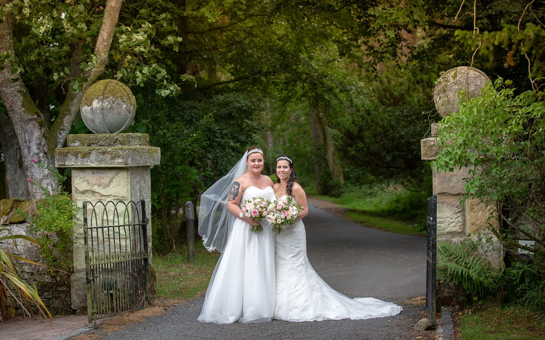 photo of brides outside Woodhill Hall