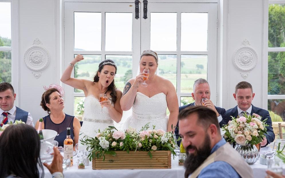 Photo of brides during wedding speeches