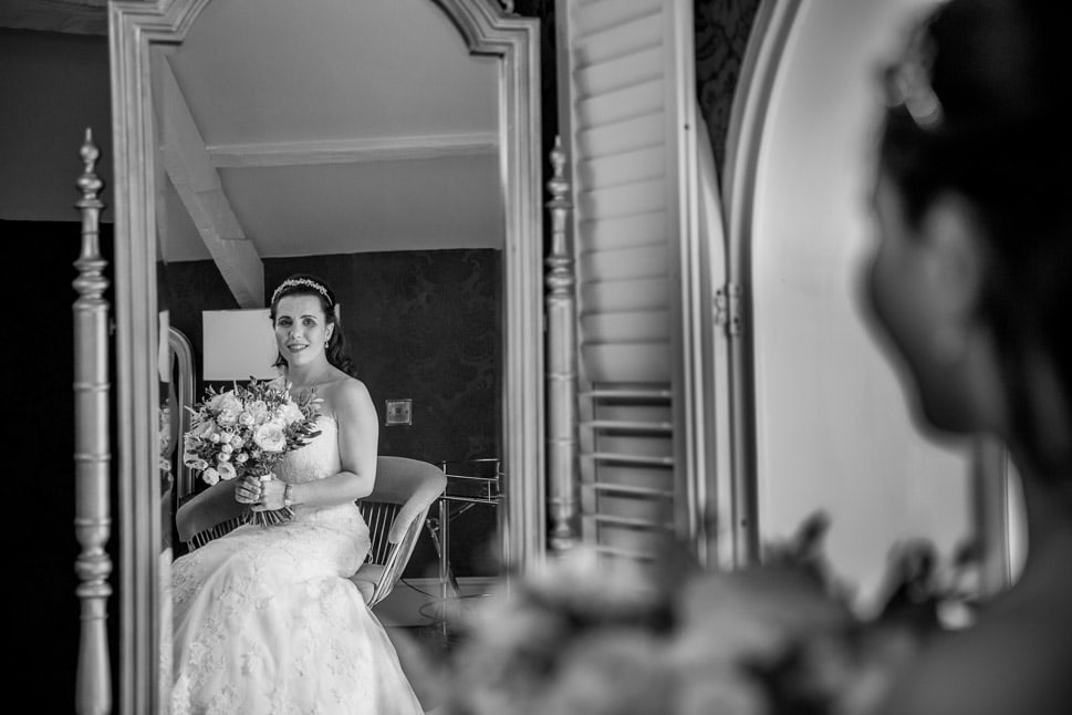 Bride looking in Mirrow