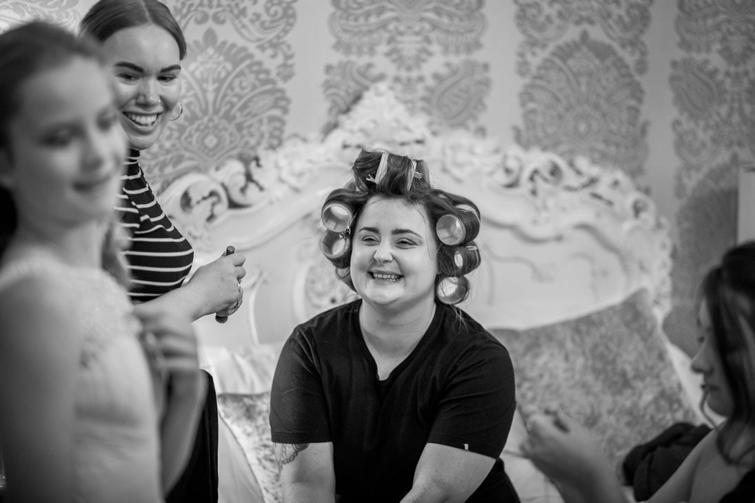 Black and White photo of bride laughing at Woiodhill Hall