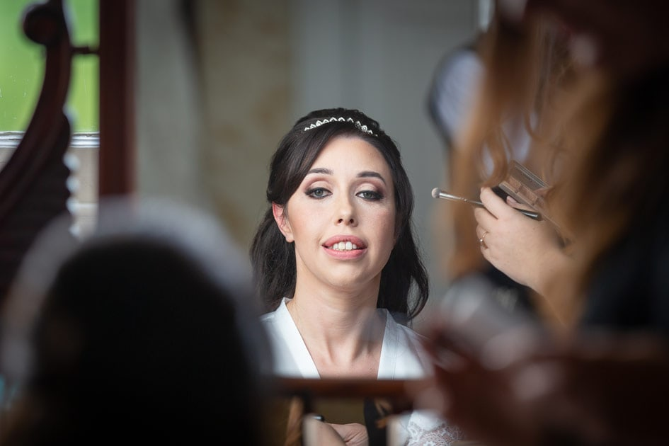 Bride lookinging in Mirror at Wynyard Hall