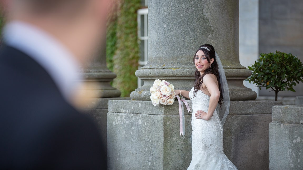 Photo of bride looking at Groom at Wynyard Hall