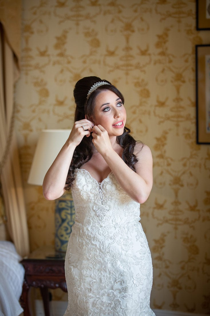 Bride putting her earings in at Wynyard Hall