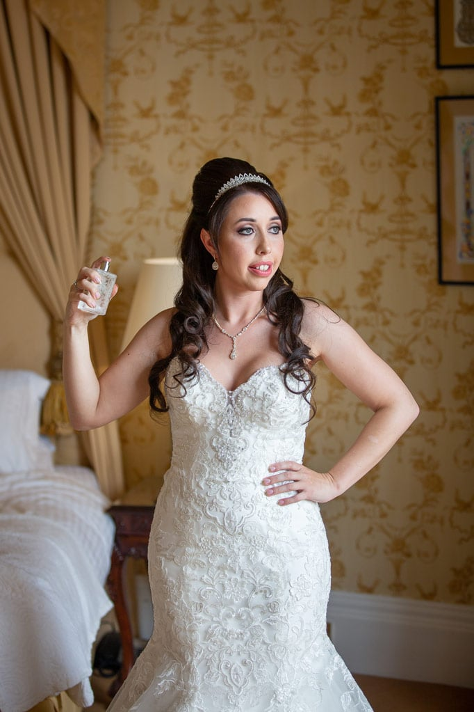 Bride spraying perfume at Wynyard Hall