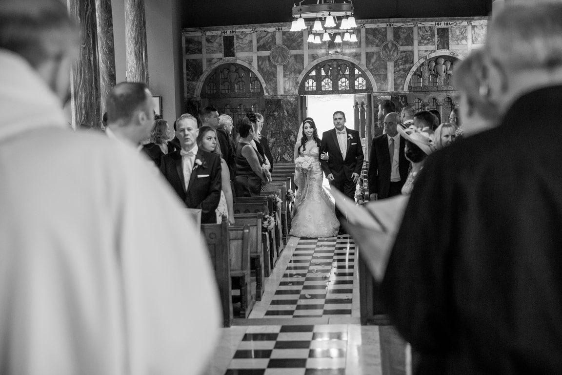 photo of Bride walking down aisle at Wynyard Hall