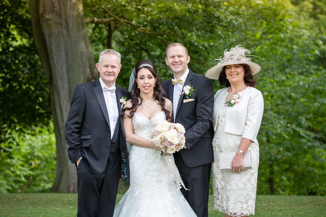 Photo of bride and groom with Parents