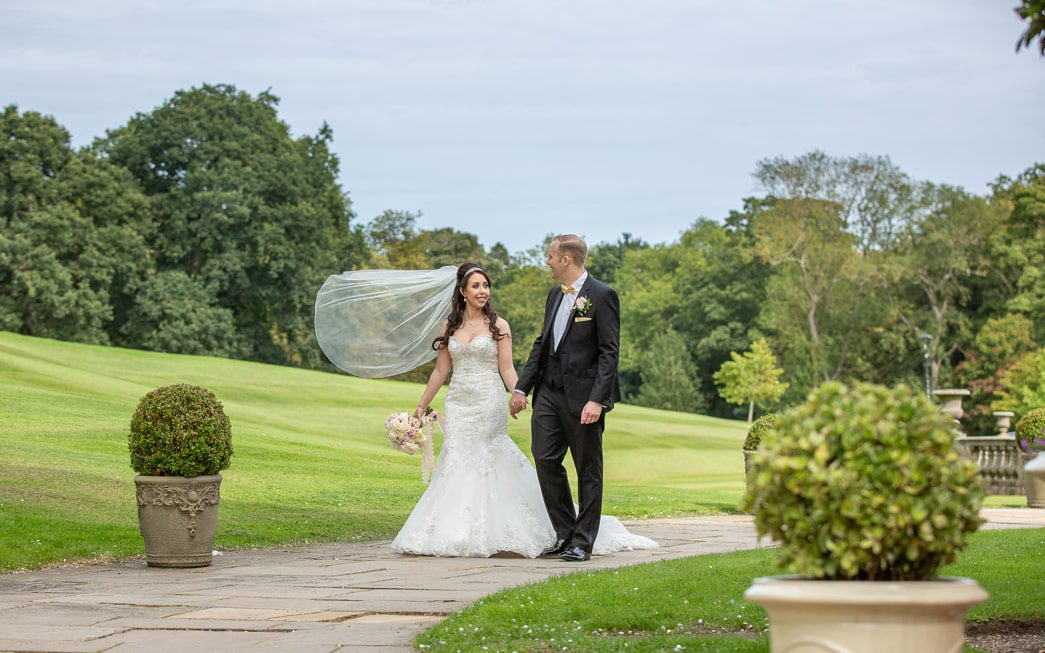 Bride and groom walking at Wynyard Hall