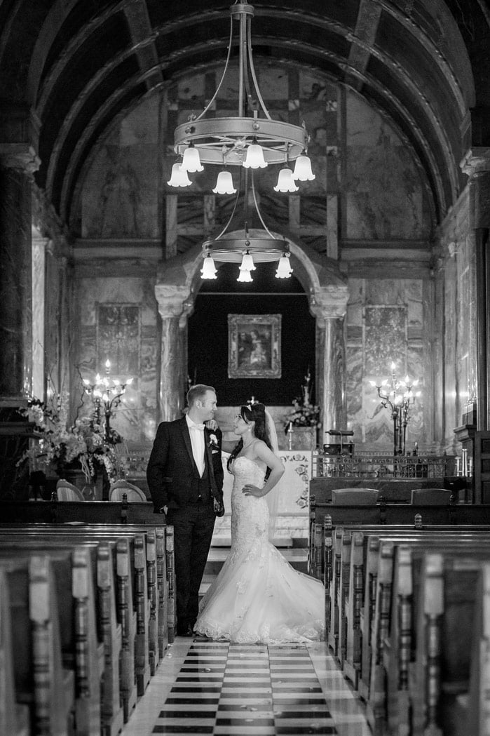 Photo of bride and groom at Wynyard Hall chapel