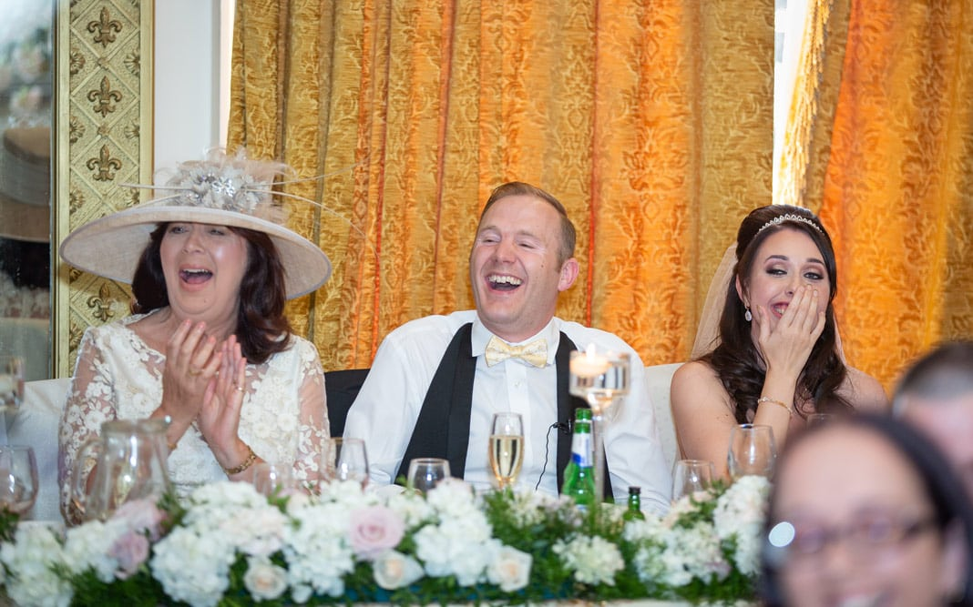 Photo of groom laughing at Wynyard hall